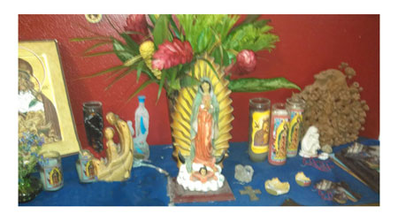 Mary House altar with the Virgin of Guadalupe, the house patroness, in the center.